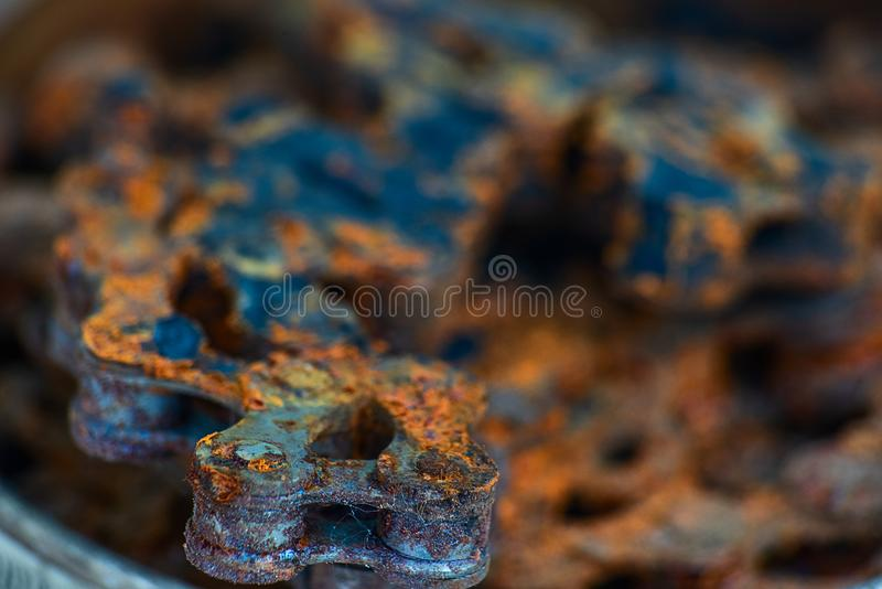 Blue with brown rusty industrial roller chain, soft focus. Blue with brown rusty industrial bush roller chain, soft focus, mechanical, steel, iron, old, industry stock images