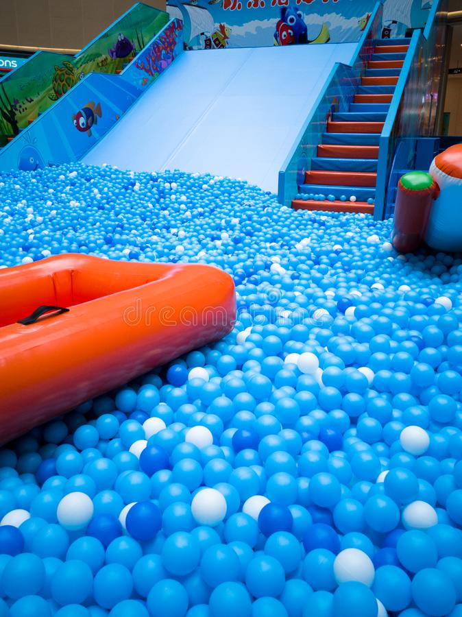 Bubble pool for kids with toys. Blue bubble pool for kids, child and children. play inside like swiming in the sea for fun. execise to improve the baby action. a royalty free stock photos