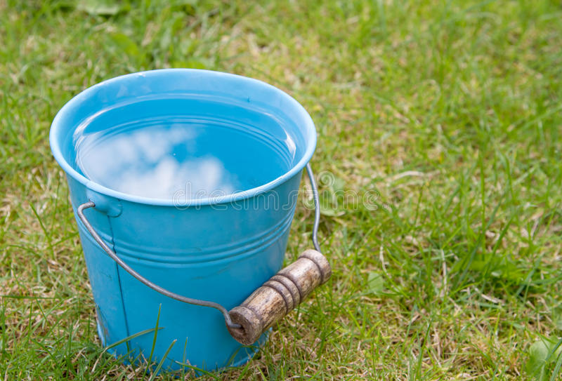 Blue bucket of water royalty free stock photography