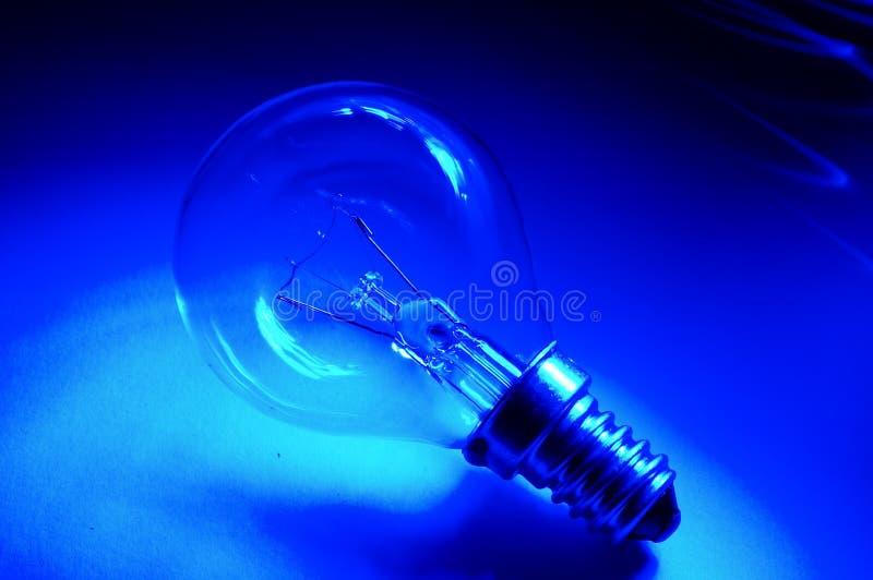 Blue bulb. Lightbulb over blue background stock image