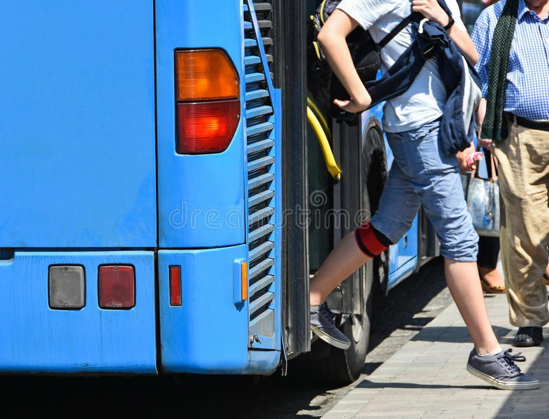 Blue bus at the stop stock photography