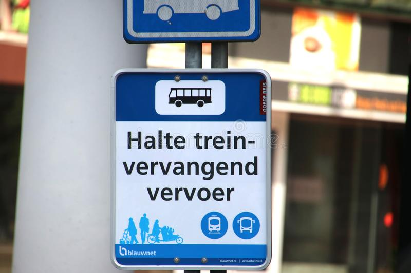 Blue bus stop sign at Zwolle station for replacement traffic when trains are not running stock photo