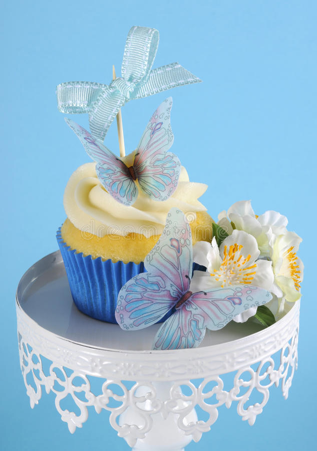 Blue butterfly theme cupcake stock photography