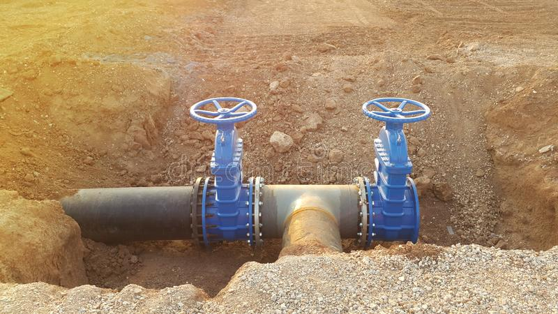 Blue butterfly valve on floor and PE. black pipe. For raw water pump royalty free stock photography