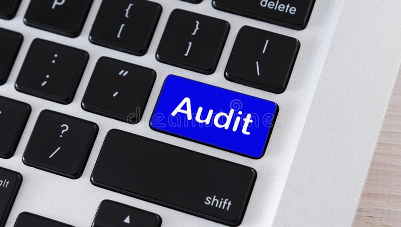 Blue button with word Audit on computer keypad. Checkup concept. Blue button with word Audit on computer keypad stock image