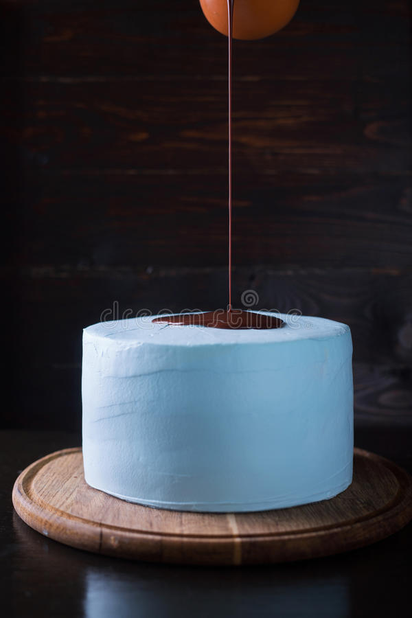 Blue cake decorated with chocolate frosting royalty free stock photo