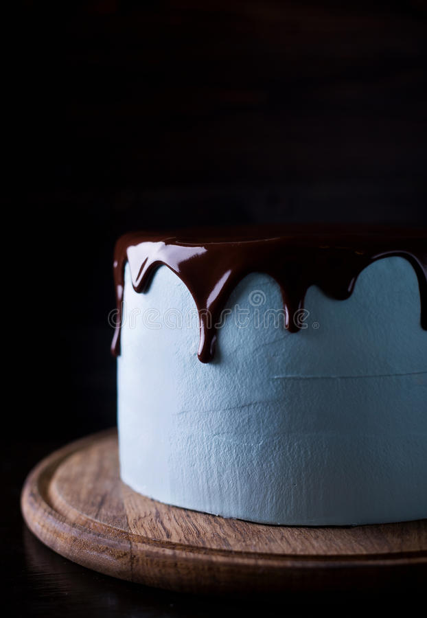 Blue cake decorated with chocolate frosting royalty free stock photography