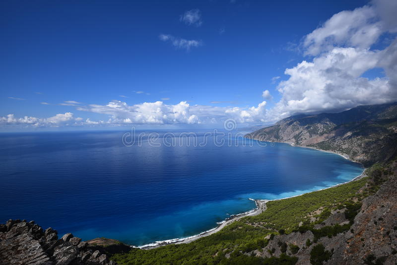 Blue Calm Sea Near High Rise Mountain Under Blue Sky During Daytime Free Public Domain Cc0 Image