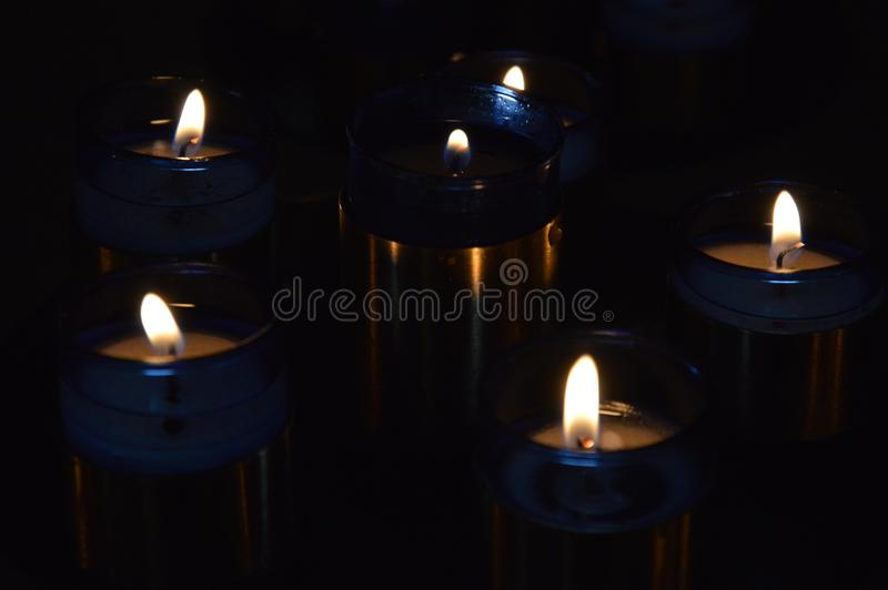 Blue Candels in a small Chuch. Zoom on Blue Candels in a small Chuch stock images