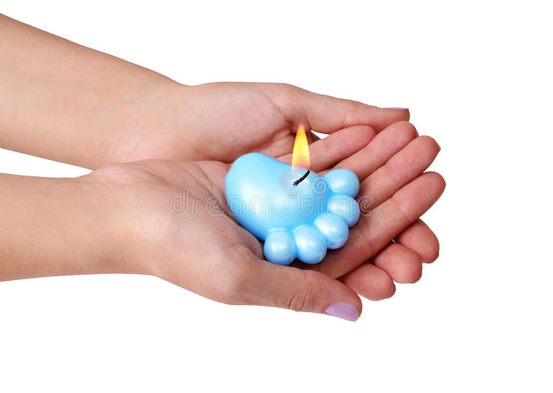 Blue candle for baby shower in hands