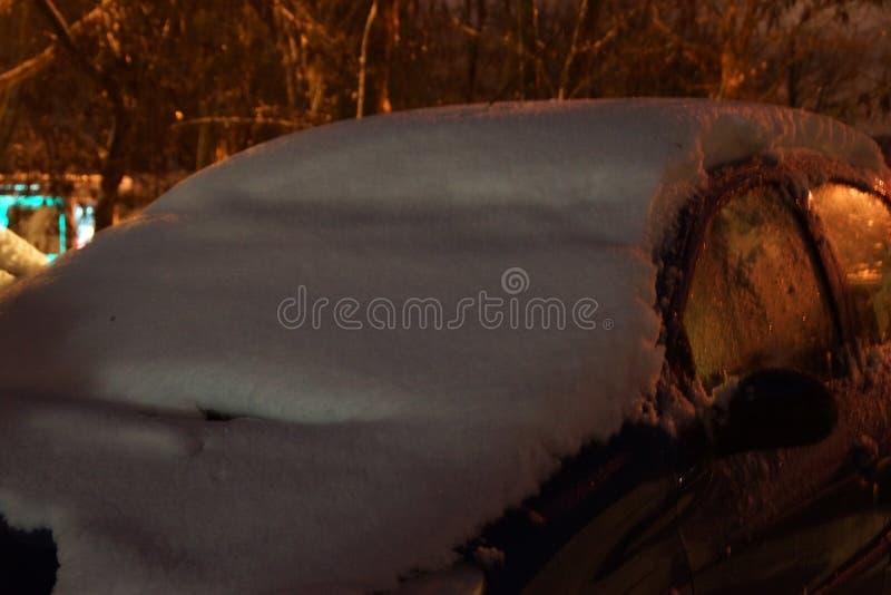 A blue car covered with snow stock photos