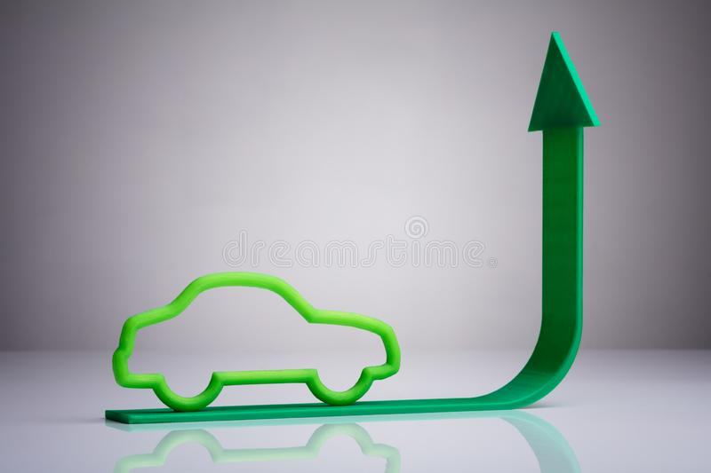 Blue Car Driving On Green Upward Arrow. Against Gray Background stock image