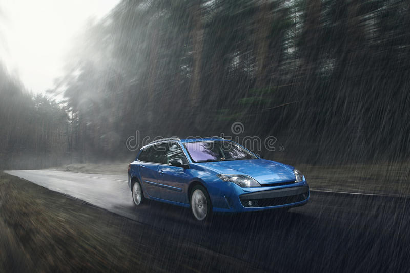 Blue car fast drive on wet road in rain at daytime. Blue car drive on wet road in rain at daytime stock photography
