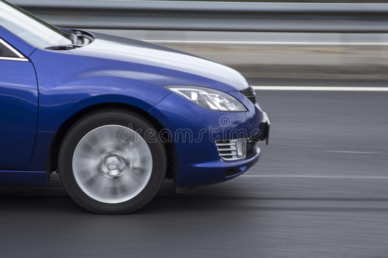 Blue car fast rigde on the road royalty free stock photography