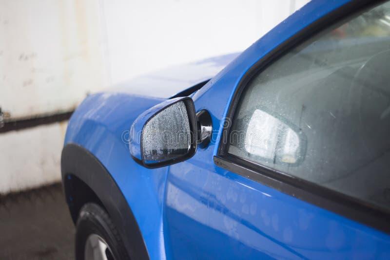 Blue car freshly washed royalty free stock image