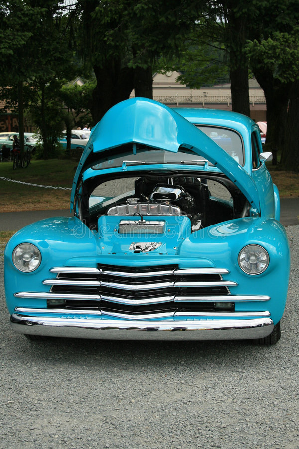 Blue car with hood up royalty free stock image