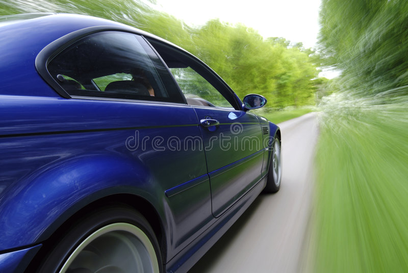 Blue Car Speeding royalty free stock photos