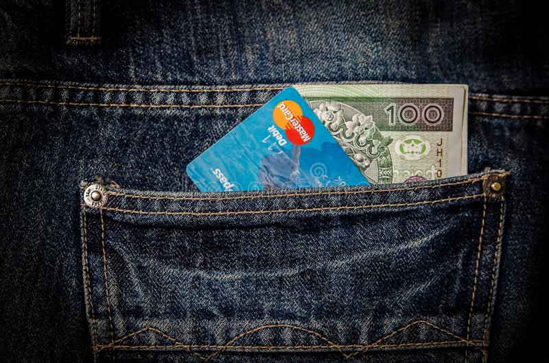 Blue Card and 100 Banknote in Pocket royalty free stock photography