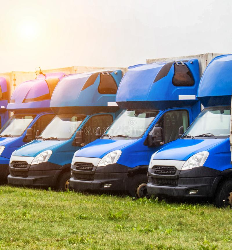 Blue cargo vans stand in a row, trucking and logistics, trucking industry. Blue cargo vans stand in a row, trucking and logistics, transportation royalty free stock photo