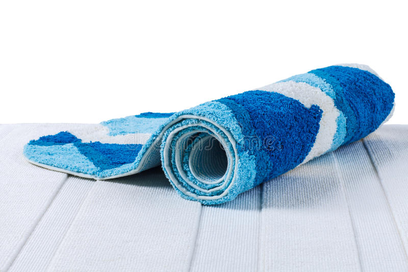 Blue carpet rolled up royalty free stock image