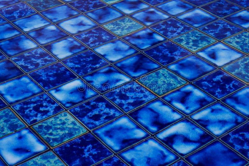 Blue ceramic mosaic background stock images