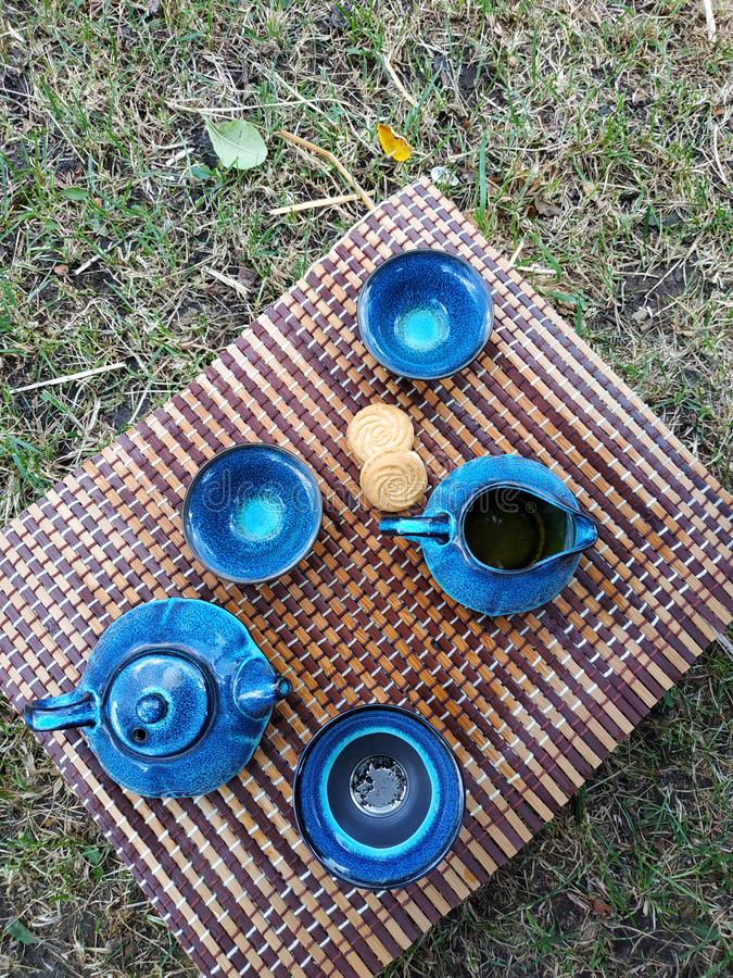 Blue ceramic teapot served with black and green tea. With two cookies. Top view, antioxidant, antique, aromatic, art, beverage, bowl, breakfast, brew, buds stock images