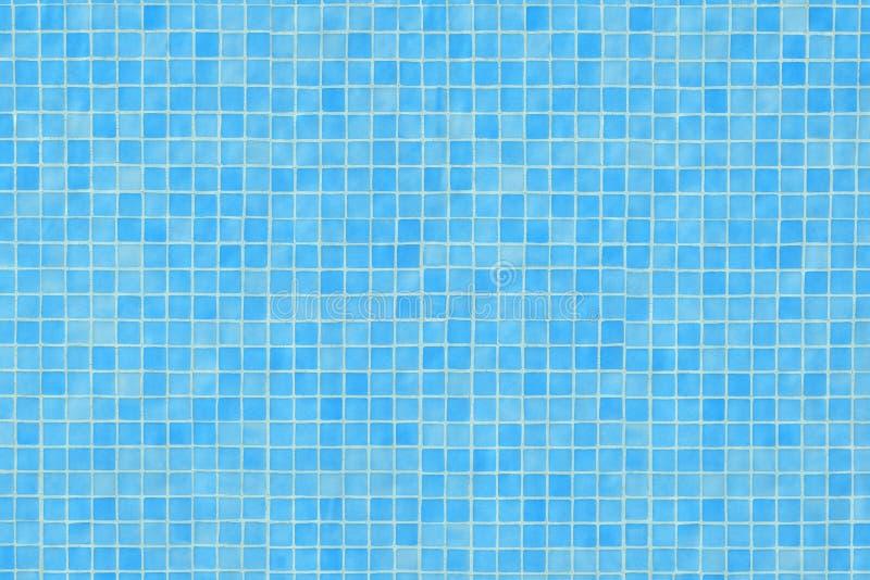 Blue ceramic tile mosaic in swimming pool stock image