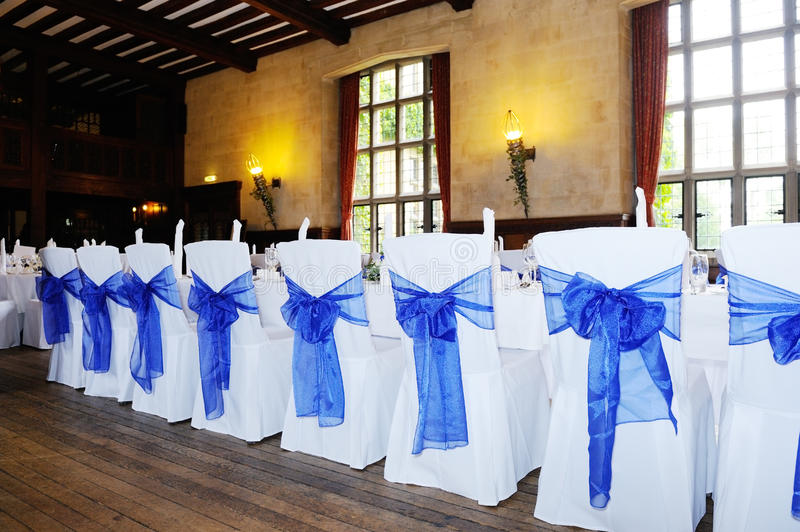 Blue chair cover. Blue and white chair covers at wedding reception stock photo