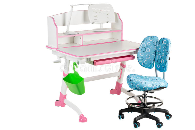 Blue chair, pink school desk, green basket and desk lamp royalty free stock image