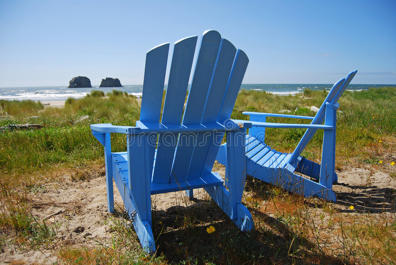 Blue Chairs on the Beach royalty free stock photo