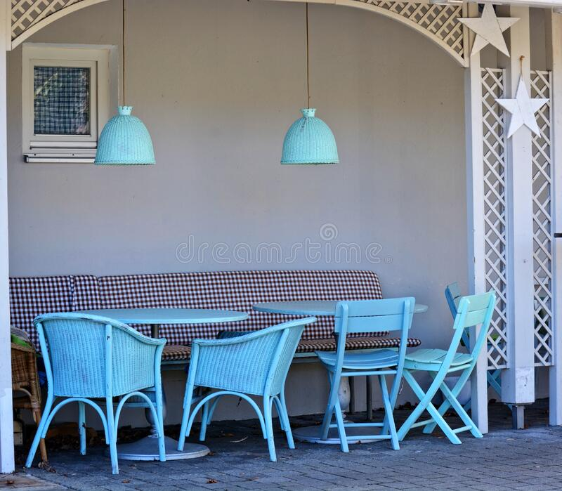Blue chairs in small alcove stock images