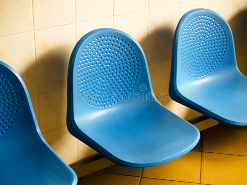 Blue chairs in waiting room royalty free stock photography