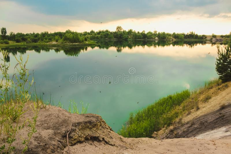 Blue chalk quarries landscape closeup in summertime. City Bereza, Belarus royalty free stock images