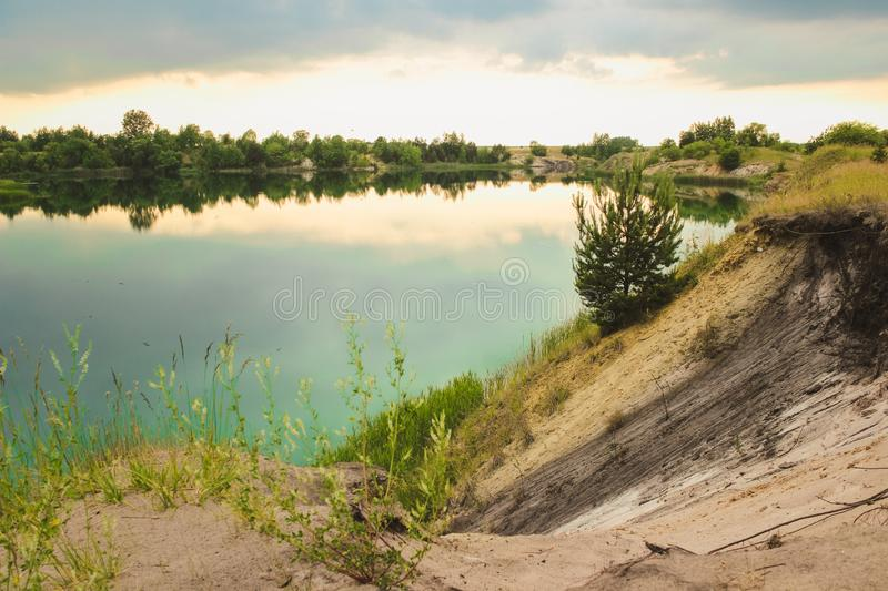 Blue chalk quarries landscape closeup in summertime. City Bereza, Belarus.  royalty free stock image