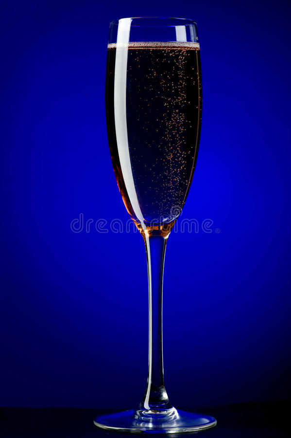 On blue champagne glasses stock image