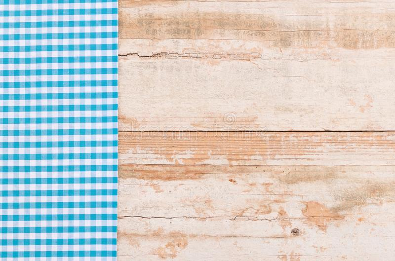 Old kitchen table top background with vintage blue checked tablecloth stock photo