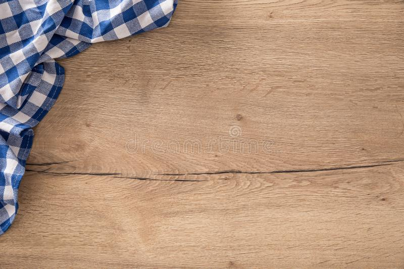 Blue checkered tablecloth on wooden kitchen table royalty free stock photos