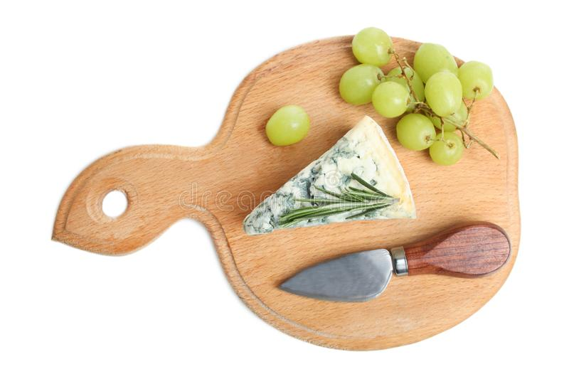 Blue cheese, grapes and knife stock image