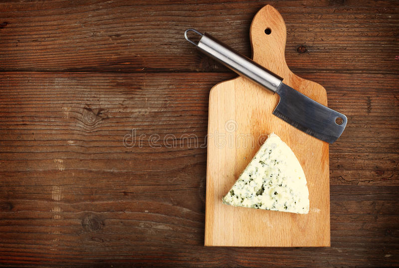 Blue cheese and knife royalty free stock photography