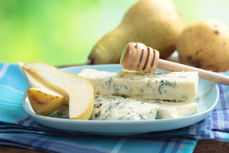 Blue cheese, pear, and honey royalty free stock photography