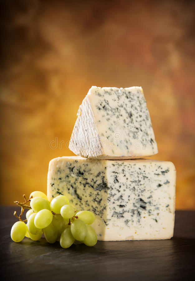 Blue cheese on wooden table stock images