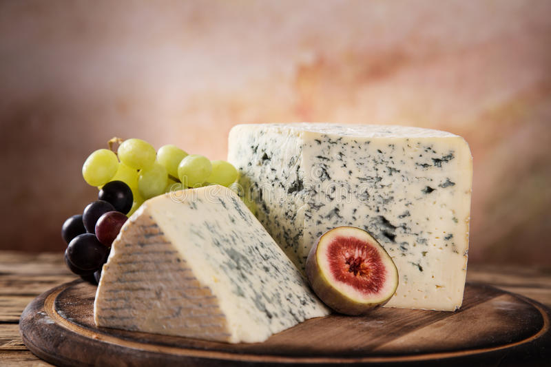 Blue cheese on wooden table stock photo