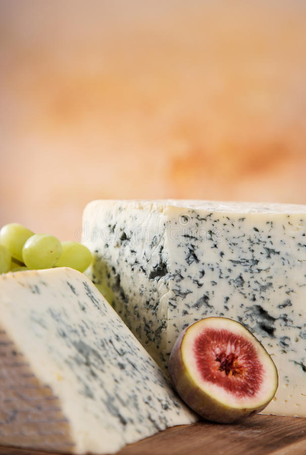Blue cheese on wooden table stock image