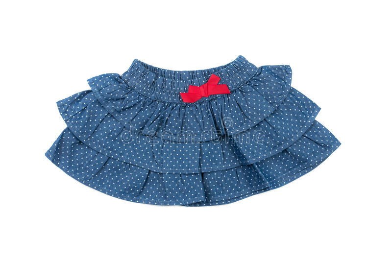 Blue children skirt with white dots, isolated on white stock image