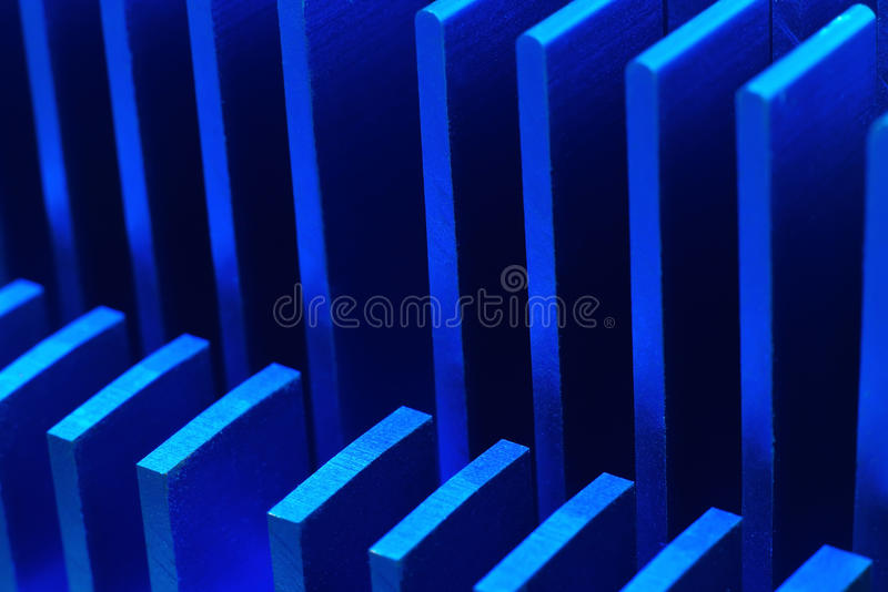Blue chipset heatsink. On motherboard, close up stock photography