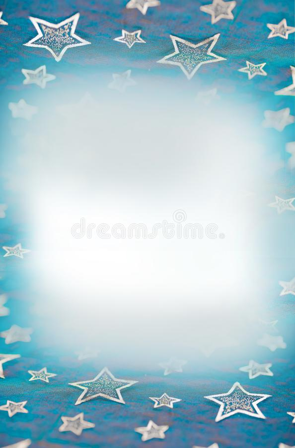 Blue christmas background with bright stars, white copy space royalty free stock photography