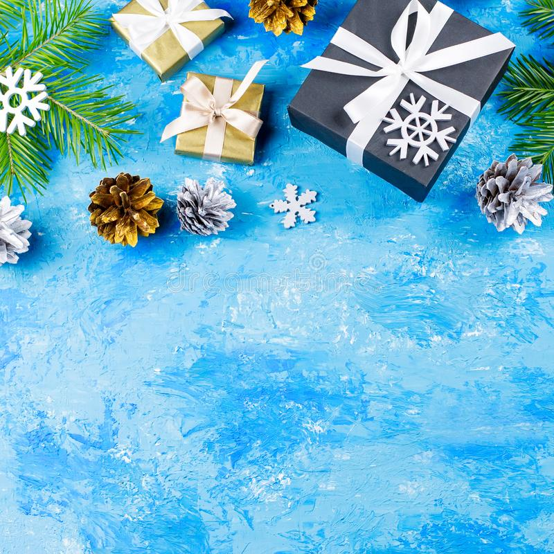Blue Christmas background with fir branches, giftboxes, silver and golden decorations, copy space royalty free stock photos