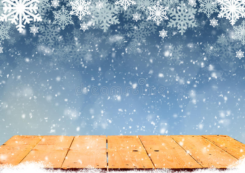 Blue Christmas background with wooden table. And white snowflakes royalty free illustration