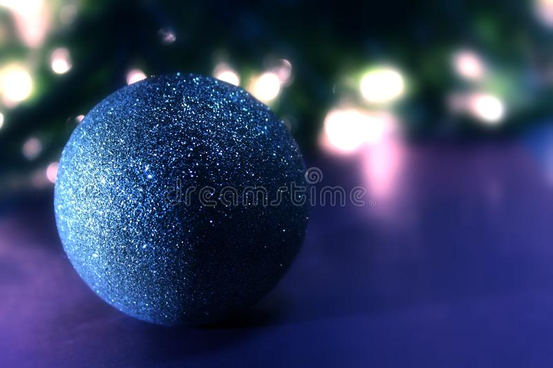 Blue christmas ball .  Christmas tree and lights. Blue christmas ball .  Festive decoration on bokeh background.. Christmas tree and lights royalty free stock photography