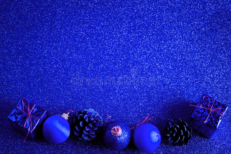 Blue christmas ball and gift decoration glitter background. Blue christmas ball and gift decoration on the glitter background stock image